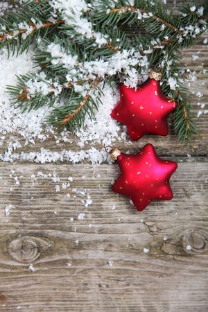 Red Christmas decorations on spruce branches with snow Stock Photo - 15990578
