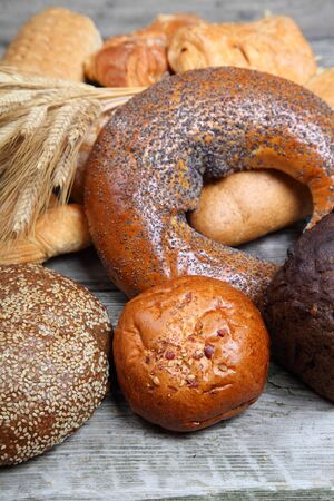 Various bread and ears on a wooden background close-up photo