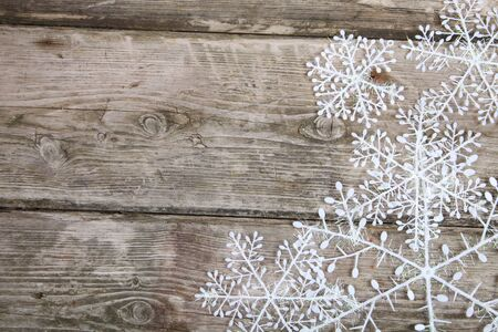 Christmas snowflakes on a wooden background  Imagens