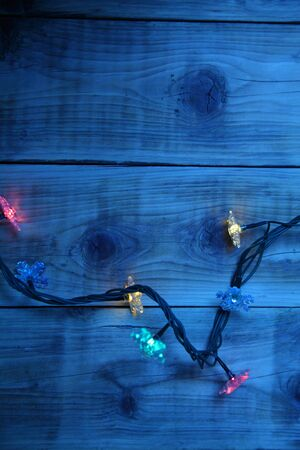 Christmas lights on a wooden background with copy space. Decorative garland  photo