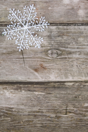 Christmas snowflake on a wooden background  Stock Photo - 16688576