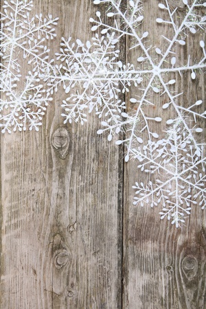 Christmas snowflakes on a wooden background  Stock Photo