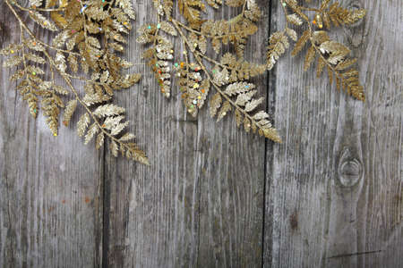 Golden Christmas twig  on a wooden background Stock Photo - 16688588