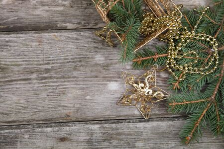 Christmas still life with golden ornaments on a wooden table Stock Photo - 16688585