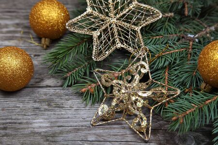 Christmas still life with golden ornaments on a wooden table Stock Photo - 16688582
