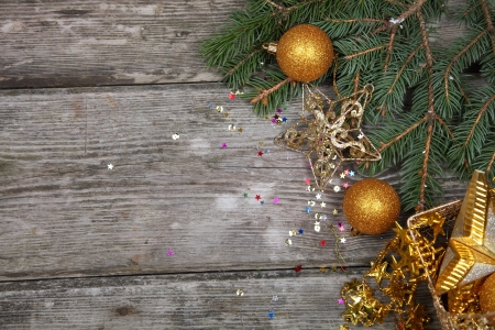 Christmas still life with golden ornaments on a wooden table Stock Photo - 16688590
