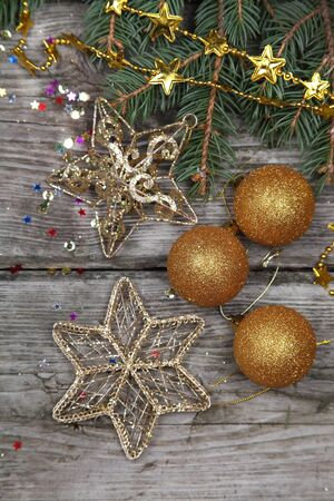 Christmas still life with golden ornaments on a wooden table Stock Photo - 16688583