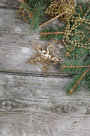 Christmas still life with golden ornaments on a wooden table Stock Photo - 16920638