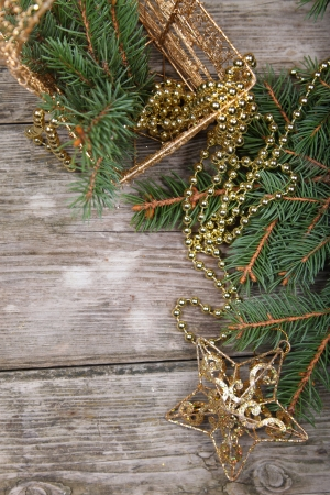Christmas still life with golden ornaments on a wooden table Stock Photo - 16920636
