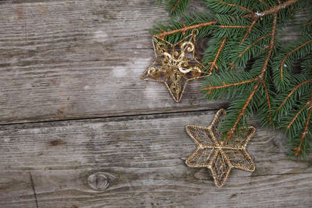 Christmas still life with golden ornaments on a wooden table Stock Photo - 16920671