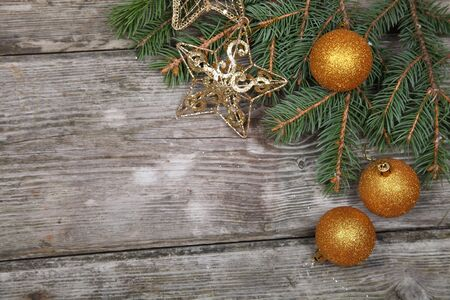 Christmas still life with golden ornaments on a wooden table Stock Photo - 16920645