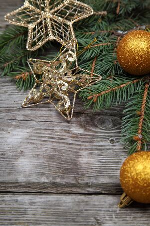 Christmas still life with golden ornaments on a wooden table Stock Photo - 16920625