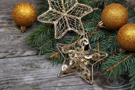 Christmas still life with golden ornaments on a wooden table Stock Photo - 16920650
