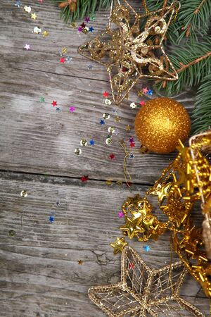 Christmas still life with golden ornaments on a wooden table Stock Photo - 16920670