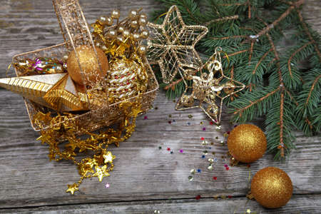Christmas still life with golden ornaments on a wooden table Stock Photo - 16920646