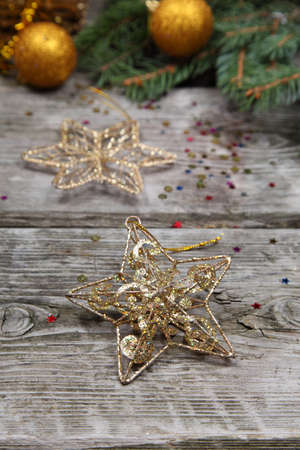 Christmas still life with golden ornaments on a wooden table Stock Photo - 16920602