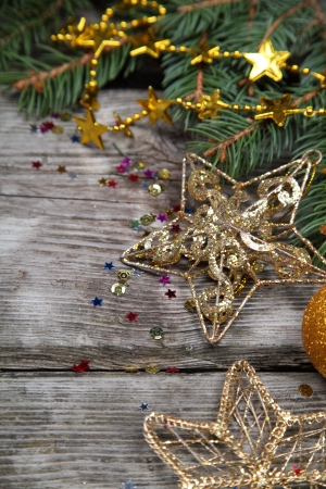 Christmas still life with golden ornaments on a wooden table Stock Photo - 16920627