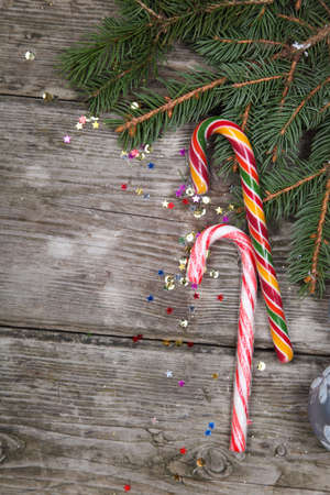 Christmas candy and spruce branches on a wooden table Stock Photo - 16920639