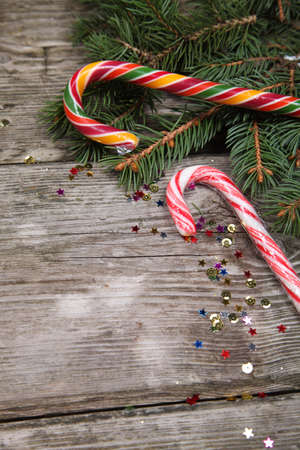 Christmas candy and spruce branches on a wooden table Stock Photo - 16920637