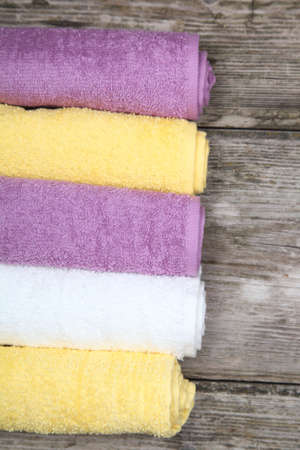 Colorful towels on a wooden background Stock Photo - 16920597