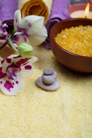 Spa still life: soap, salt for baths, a flower and towels Stock Photo - 16920596