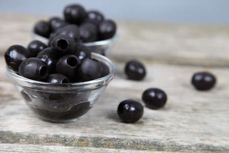 Black olives on a wooden table Stock Photo - 16920585
