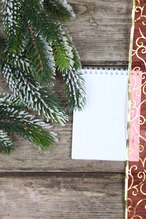 Christmas fir tree and paper on the wooden board  Stock Photo - 16920603