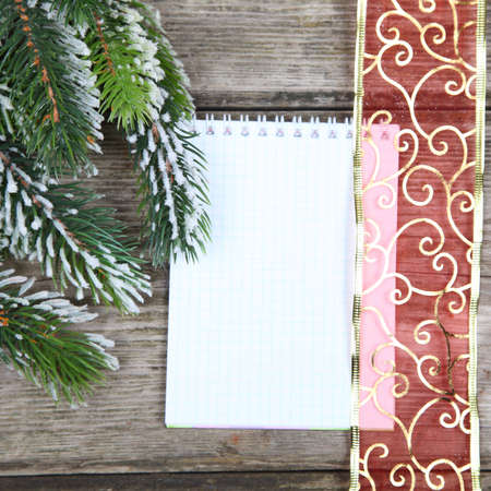 Christmas fir tree and paper on the wooden board Stock Photo - 16920559