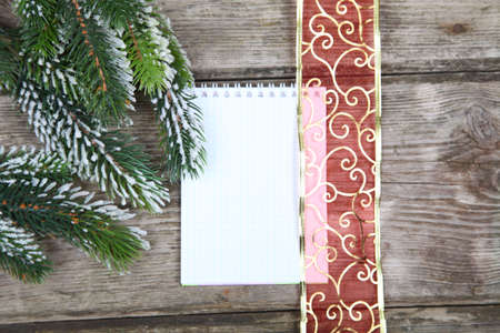 Christmas fir tree and paper on the wooden board Stock Photo - 16920606