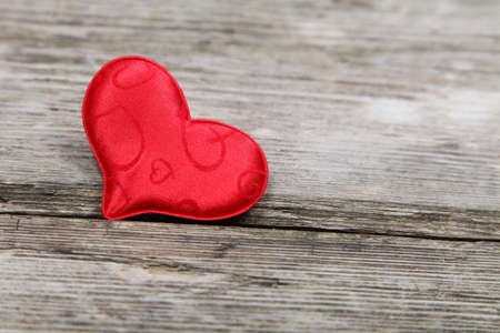 Red heart on a wooden background. Valentines Day.  Stock Photo - 16920600