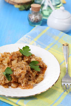 saltwort: Stewed cabbage on a blue wooden table Stock Photo