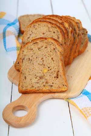 pastil: Sliced bread on a wooden board on the table