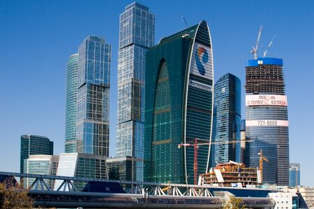 referred: MOSCOW. RUSSIA - SEPTEMBER 17, 2012: Skyscrapers of Moscow city business center closeup. Moscow International Business Center also referred to as Moscow-City is commercial district in central Moscow, Russia Editorial
