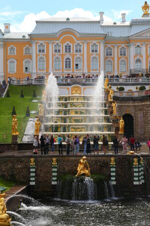 petergof: ST PETERSBURG, RUSSIA - AUGUST 2, 2015: Grand cascade at Pertergof Palace. The Petergof palace included in the UNESCOs World Heritage List.