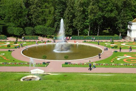 petergof: ST PETERSBURG, RUSSIA - AUGUST 2, 2015: Fountain Large Bowl at Pertergof Palace. The Petergof palace included in the UNESCOs World Heritage List.