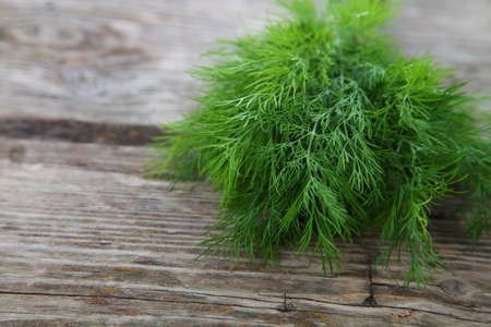 dill: Dill on a wooden background