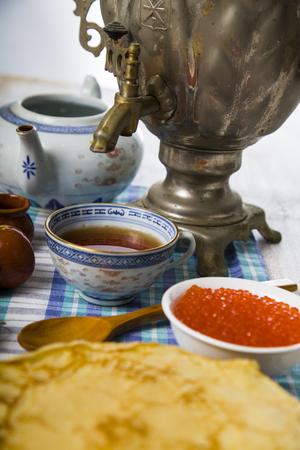 meat and alternatives: Pancakes with red caviar on a table. Shrovetide.