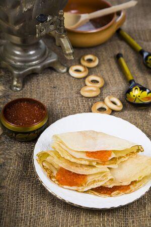 samovar: Pancakes with caviar on the table with a samovar. Shrovetide. Stock Photo