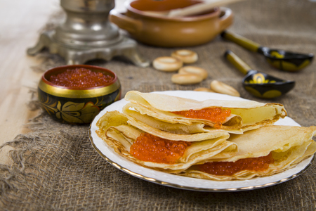 meat and alternatives: Pancakes with caviar on the table with a samovar. Shrovetide. Stock Photo