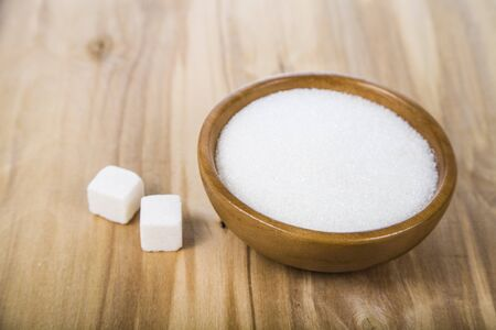 fructose: Sugar in a wooden bowl on the table