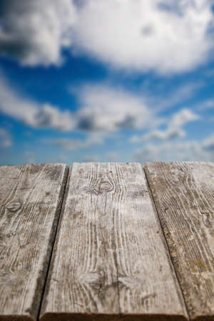 heavenly: Old wooden table close-up and the heavenly landscape in the background