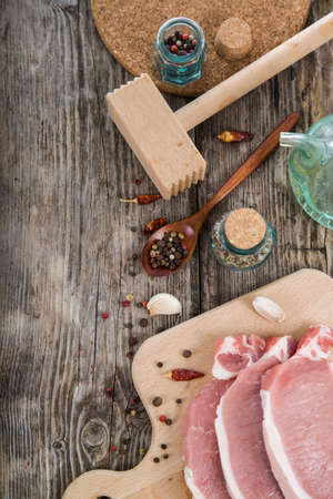 meat alternatives: Raw meat with spices on a wooden table