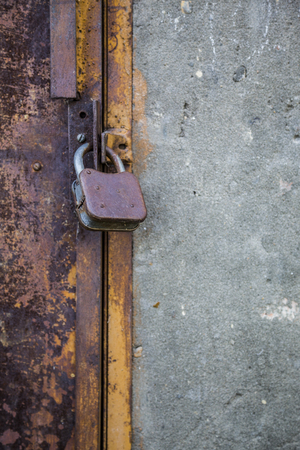 Old rusty door with a lock close up.