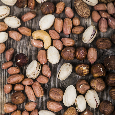 Background of nuts. Different kinds of tasty and healthy nuts. Stock Photo