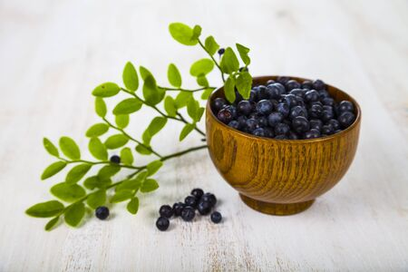 Blueberries in a wooden bowl on a wooden table Stock Photo
