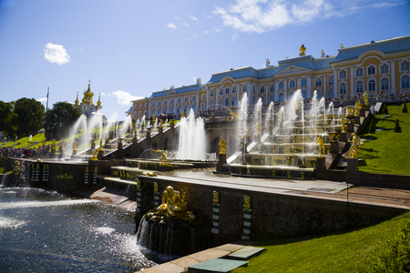 ST PETERSBURG, RUSSIA - AUGUST 2, 2015: Grand cascade at Pertergof Palace. The Petergof palace included in the UNESCOs World Heritage List.