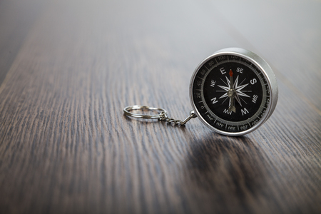 Compass on a wooden table. The concept of travel around the world and tourism.