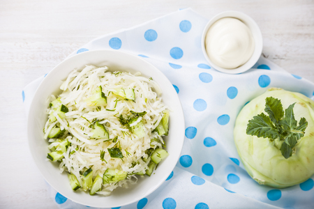Salad with kohlrabi, cucumber and dill. Vegetarian food. Tasty and healthy dish. Healthy eating.
