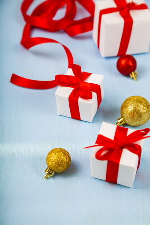 gifts with red bows and christmas decorations on a blue wooden background congratulations on new