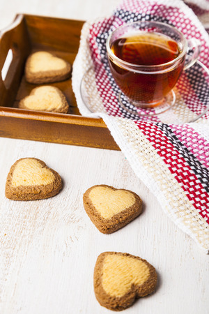 Heart-shaped cookies and tea for St. Valentines Day. Romantic breakfast. Greeting card for St. Valentines Day.